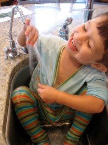toddler in sink