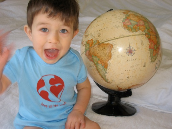 Our youngest tender sapling traveler, sporting his Love All the World shirt.