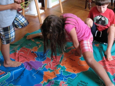 Kids from the US and China playing a twister-like geography game..