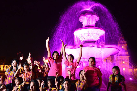 Festivities at the fountain in Central Park, Guatemala City - lit up pink for the International Day of the Girl (photo: Plan International)