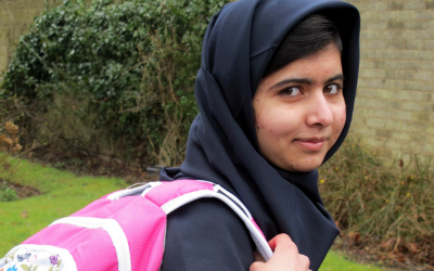 malala with pink backpack